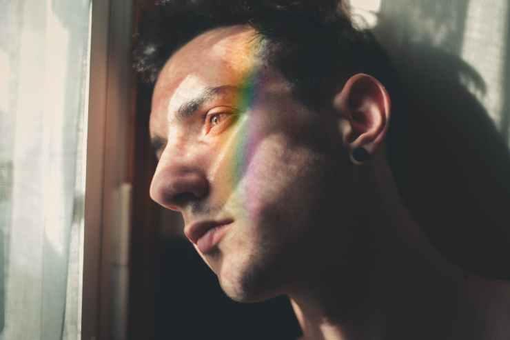 man leaning near window